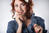 Portrait of young red-haired girl in fashion style