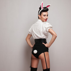 Pinup styling girl posing in vintage bunny costume