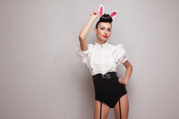 Sexy pinup model posing in vintage bunny costume