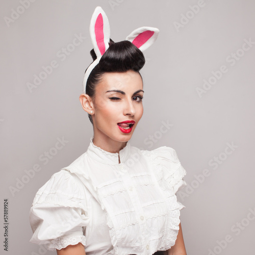 Square portrait of pretty bunny girl winking and tongue out