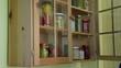 hand open wooden cupboards door puts jar canned garlic