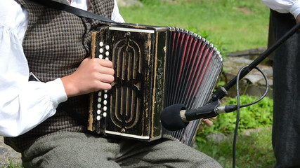 Accordionist young man play folk music with accordion