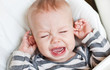 cute little boy crying holding his ear - 57891972