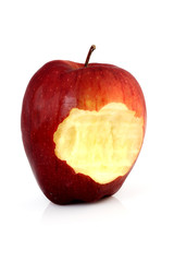 Bitten red apple on a white background