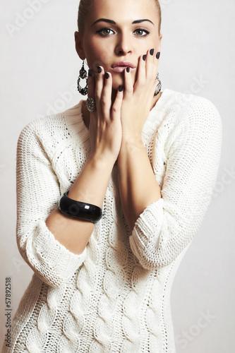 beautiful woman in white woolen dress.hairless.winter fashion