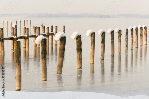 Snow Capped Pier Posts on a Frozen Lake I
