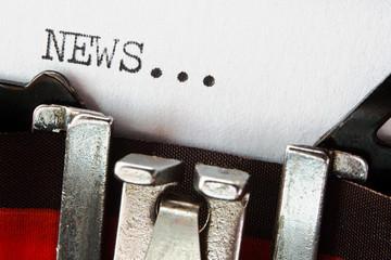 news text on retro typewriter