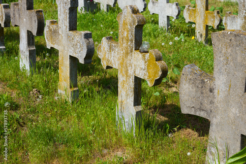 old graves headstones and crucifixes of a cemetery
