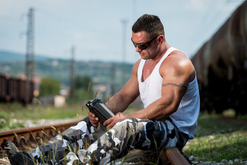 Bodybuilder Resting And Drinking Protein Shake