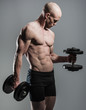 fit male with dumbells