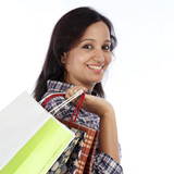 Portrait of young Indian girl holding shopping bags