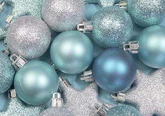 Festive background of aqua blue christmas baubles