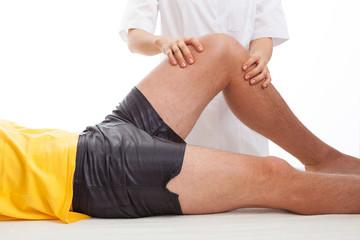 Physiotherapist massaging a leg
