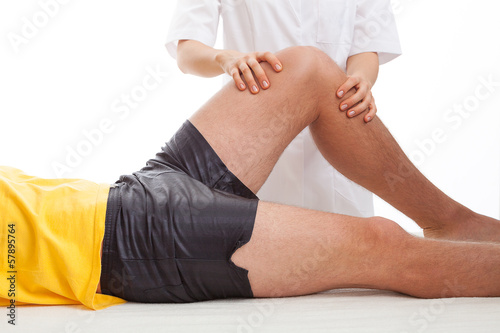 Physiotherapist massaging a leg