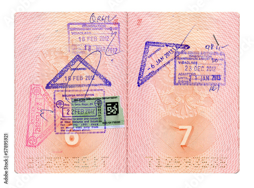 Opened Russian passport with stamps isolated on white with path