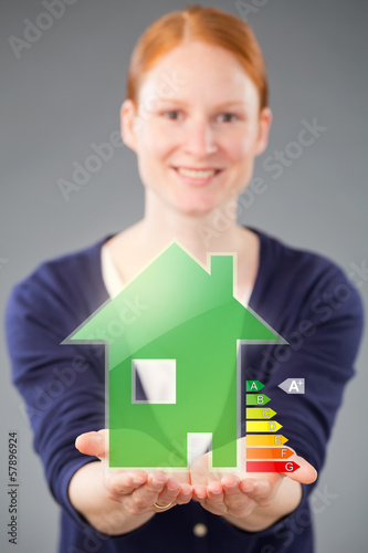 Woman with an Energy Efficient Green House