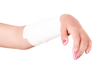 Close-up image of a white bandage wrapped on injured arm.