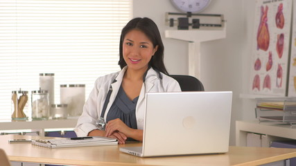 Successful Japanese doctor in her office