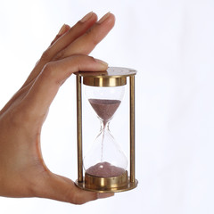 woman hand holding a hourglass