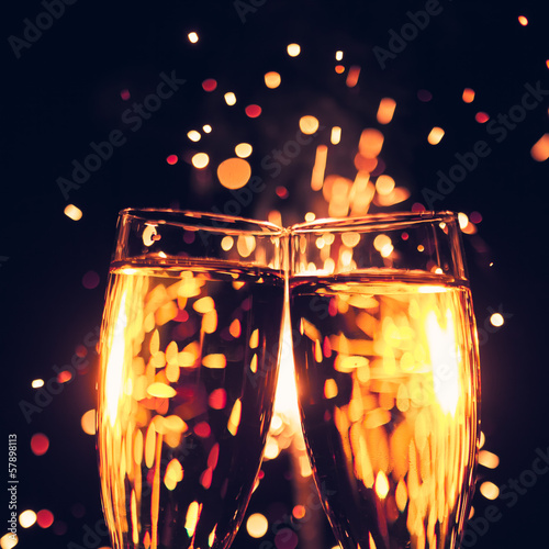 champagne glass against christmas sparkler background