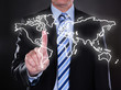 Businessman touching world map on the screen