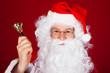 Santa holding bell