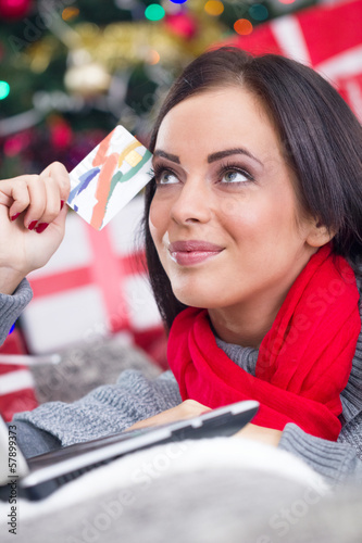 Happy Smiling Woman Using Credit Card to Internet Shop