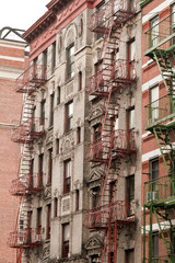 Typical NYC architecture with iron fire ladders