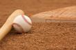 Baseball & Bat near a base