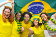 Group of happy brazilian soccer fans commemorating victory.