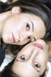 Two beautiful young girls face-to-face portrait color image