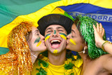 Brazilian soccer fans celebrating victory kissing each other.