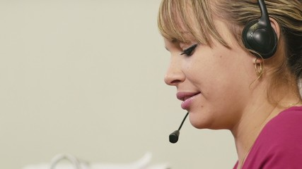 female operator in call center working as customer service repre