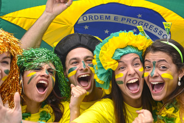 Group happy brazilian soccer fans commemorating victory.