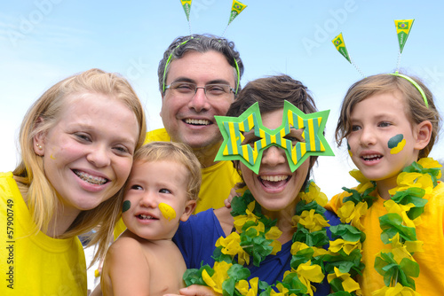 Family of brazilian soccer fans commemorating victory together
