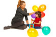 Happy mom and girl playing with balloons