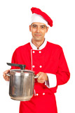 Chef male holding inox pot