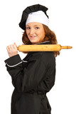 Chef woman with rolling pin on shoulder