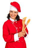 Chef woman with wooden utensils