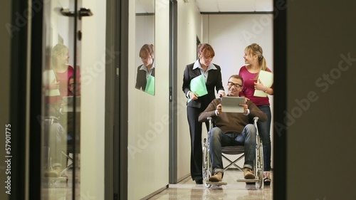 team of business people with disabled man on wheelchair