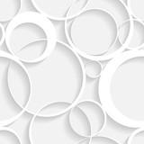Kreisförmige Gestalten in Grau und Weiß