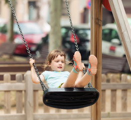 baby on swing  in city