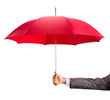 canvas print picture - Hand with an red umbrella