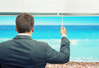 Businessman looking at sea