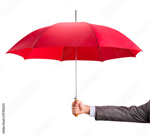 Hand with an red umbrella - 57902333