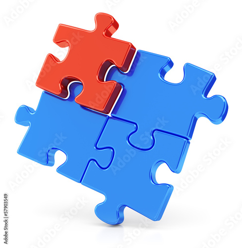 Four assembling puzzle pieces