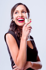 Beautiful woman holding glass of sparkling wine champagne