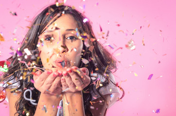 Woman playing with confetti