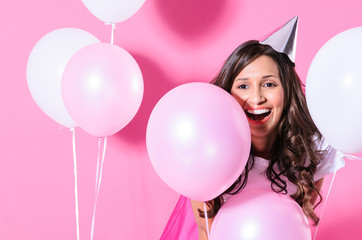 Smiling woman with pink and white balloons
