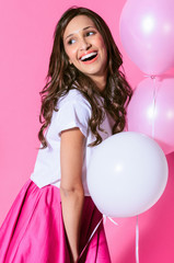 Cute smiling woman with pink and white balloons